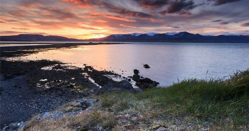 Enjoy the sunset at Hvalfjordur on a Goway trip to Iceland