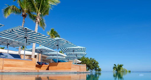 Enjoy a relaxing day by the pool at the Malamala Beach Club on your Fiji vacation