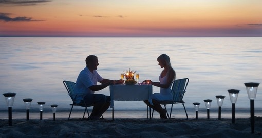 Romantic dinner on the sea sand beach