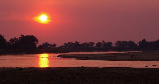 View the sunset off the Luangwa River on your Zambia tour