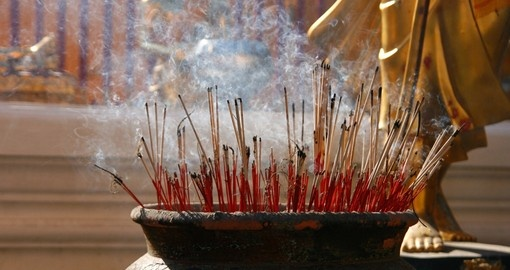 Burning incense sticks at a Buddhist temple