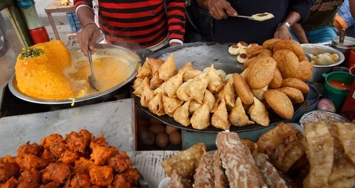 Experience traditional Nepalese food that is sold all throughout the streets of your Nepal Vacations