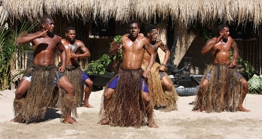 A group performs an island dance