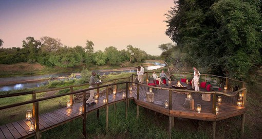 "Enjoy ""sundowners"" on the deck overlooking the Luvuvhu River"