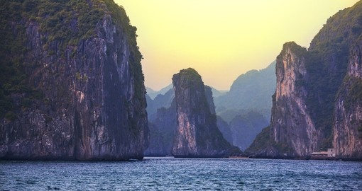 Explore Halong Bay at sunset during your next trip to Vietnam.