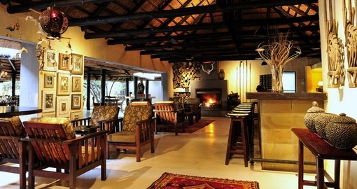 Have a nice drink at the lodges bar after a busy day in Sabi Sabi Bush Lodge on your next South Africa tours.