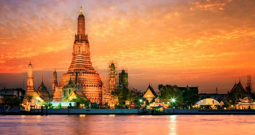 Cruise past Wat Arun at Sunset during your Thailand Vacation