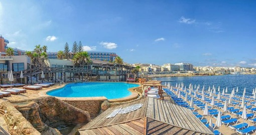Relax by the pool on your Malta vacation
