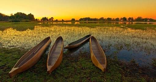 Watch the sunrise over the Okavango Delta during your Botswana vacation.