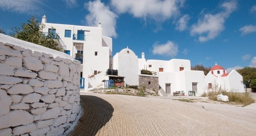 Your Greece vacation package includes a trip to Ano Mera in Mykonos.