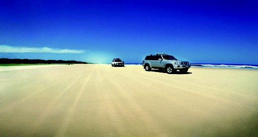 Drive along the sandy beaches littered across the Sunshine Coast during your Trips to Australia.
