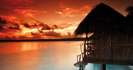 Gaze off into the sunset at the Aitutaki Lagoon Private Island Resort during your next Cook Island Trip.