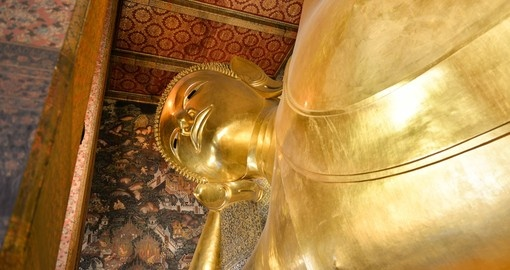 Visit Wat Po to see the giant Buddha on your Thailand vacation