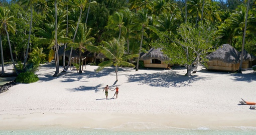 Strolling on white sand beaches in Tahiti