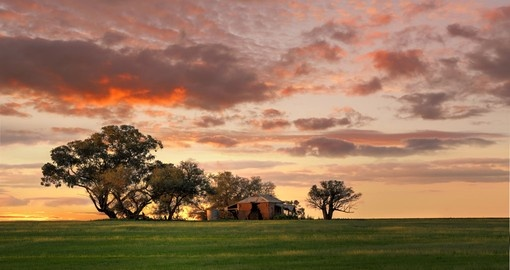 Watch spectacular sunsets in the Outback during your Australia vacation.