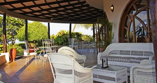 Dine on the terrace at the Royal Palm during your Galapagos tour.