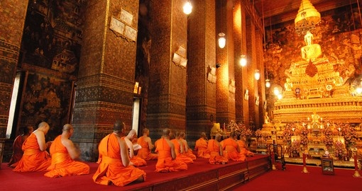 Buddha image and monks in Wat Pho Temple