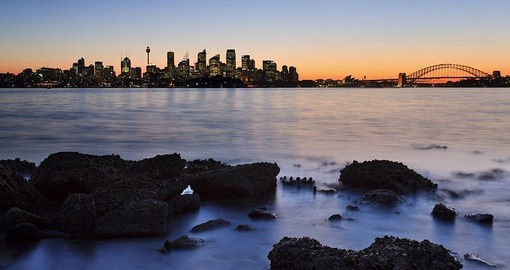 A view across the harbour at sunset is always a popular inclusion on all Sydney tours.