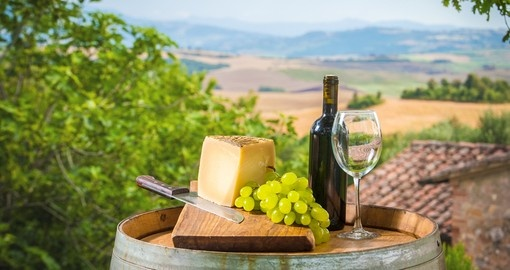 Tuscan red wine with grapes and cheese