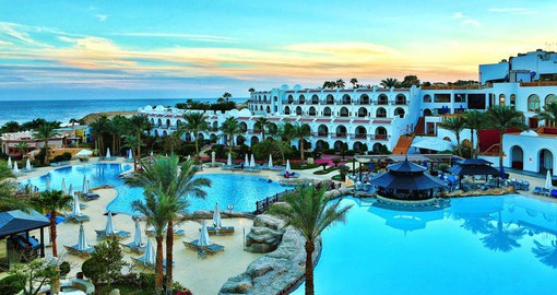 Enjoy the inviting pool and beach at the Savoy Hotel Sharm el-Sheikh