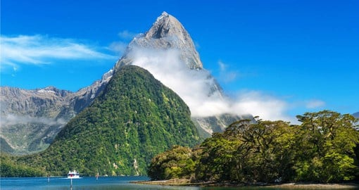The cloud-piercing summit of Mitre Peak at Milford Sound