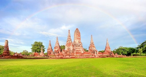 Wat Chaiwatthanaram old temple with beautiful rainbow