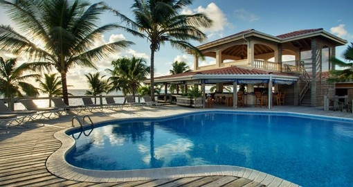 Take a refreshing dip in the swimming pool at the Sun Breeze Resort during your Belize vacation.