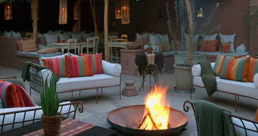 Sit around the fire and spend time with your friends/family after a Chile Tour