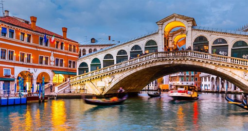 The Rialto Bridge is the oldest of the four bridges spanning the Grand Canal in Venice