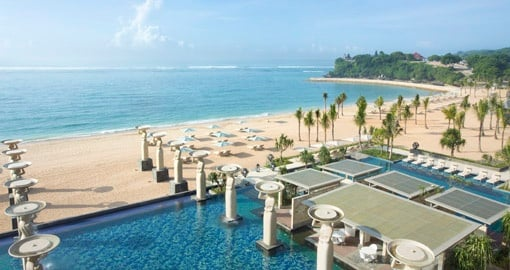 Take a stroll on the beautiful beach at The Mulia Resort in Nusa Dua