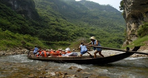 Included in your China Vacation Package is a ride in a local long boat through the Yangtze River.