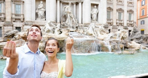 Throwing coins into Trevi Fountain