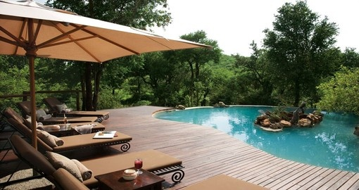 Enjoy a refreshing swim in the pool at Impodimo Game Lodge during your South Africa vacation.