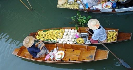 Take in the sights and smells of Damnoen Saduak Floating Market on your trip to Asia