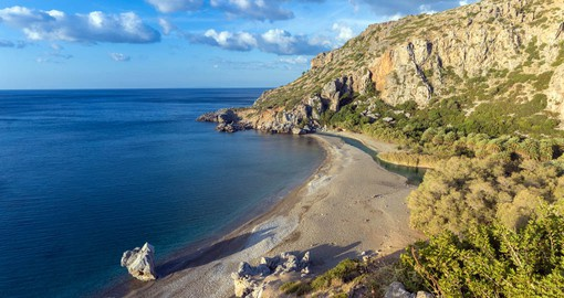 Preveli Beach, known locally as Palm Beach is at the exit of the Kourtaliotiko Gorge