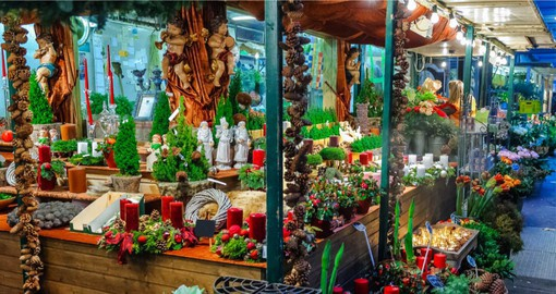 Visit the wooden stalls selling handmade Christmas wares and food