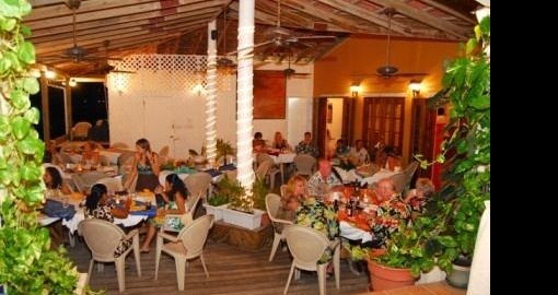 Dine at the Blue Grill Restaurant during your Belize vacation stay at the Sun Breeze Resort.