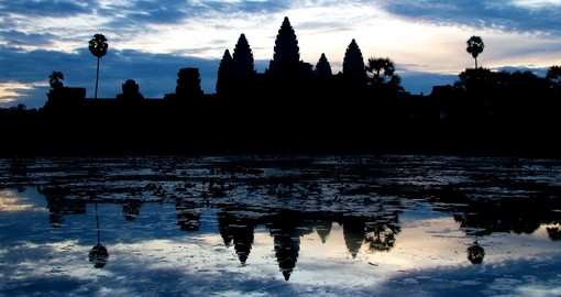 Take in a magical sunrise at Angkor Wat on your trip to Cambodia