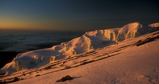 Sunrise over a glacier at the top of Mount Kilimanjaro