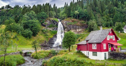 Steinsdalsfossen Waterfalls, with a fall of 50 m, is one of the most visited attractions in Norway