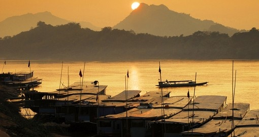 Coast along the Mekong River and enjoy the beautiful scenery of Laos on you Laos Vacation