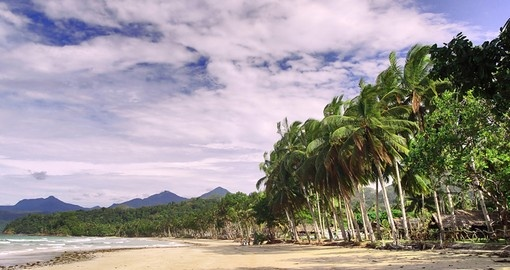Bask in the sun on the white sand Sabang Beach in Palawan on your Philippines Vacation