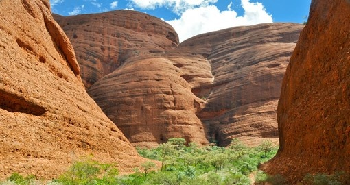 Trek through the valley of Kata Tjuta and lose yourself in the beauty of the rock formations on your Australia Vacation