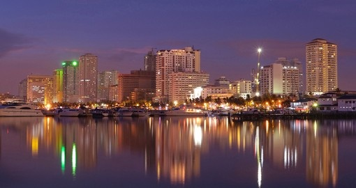 Vibrant Manila bay city night-scape and buildings reflection