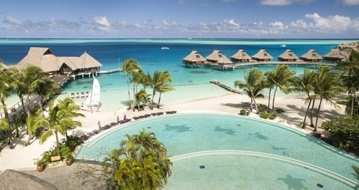 Infinity pool with swim up bar at the Conrad Bora Bora Nui is included in your Bora Bora Vacations.
