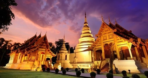 Walk along the ancient ruin pathways of the Phra Singh temple on one of your Thai Tours