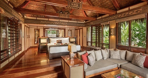 Enjoy the luxurious interior of a Deluxe Beachfront Bure on your Fiji Vacation