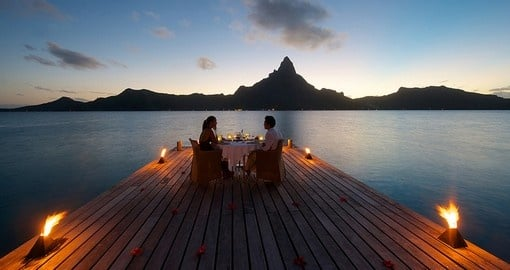 Have a romantic outdoor dinner during your next trip to Moorea.