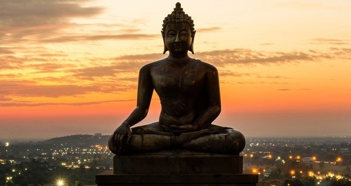 Buddha statue in sunset light over Saraburi