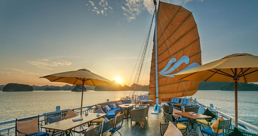 Take in the Sunset view from the deck on your Halong Bay Cruise